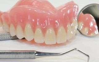 Коррекция зубных протезов, какие показания и методы перебазировки?