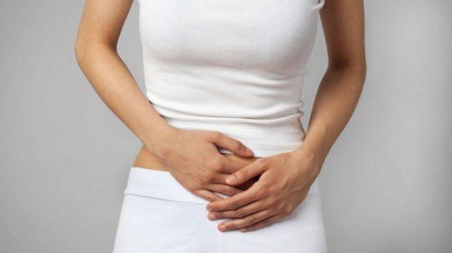 Выделения и боль внизу живота и в пояснице у женщин: белые, розовые выделения