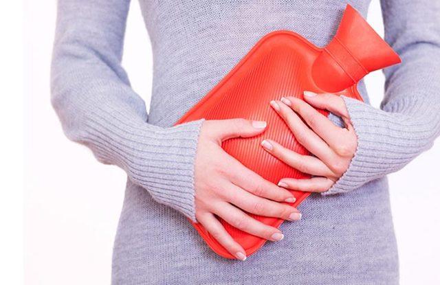 Почему болит живот при месячных и как облегчить состояние женщине