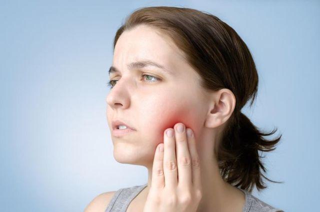 Опухла десна после лечения зуба: что делать, причины, осложнения